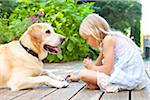 Little girl painting the claws of a dog with bright pink nail polish on a sunny summer afternoon in Portland, Oregon, USA Stock Photo - Premium Royalty-Free, Artist: Ty Milford, Code: 600-06531467