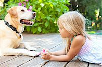 Little girl painting the claws of a dog with bright pink nail polish on a sunny summer afternoon in Portland, Oregon, USA Stock Photo - Premium Royalty-Freenull, Code: 600-06531468