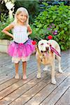 Young girl playing dress up with dog on a sunny summer afternoon in Portland, Oregon, USA Stock Photo - Premium Royalty-Free, Artist: Ty Milford, Code: 600-06531469