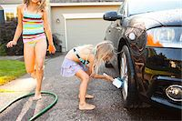 Sisters washing car in the driveway of their home on a sunny summer afternoon in Portland, Oregon, USA Stock Photo - Premium Royalty-Freenull, Code: 600-06531471