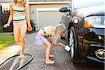 Sisters washing car in the driveway of their home on a sunny summer afternoon in Portland, Oregon, USA Stock Photo - Premium Royalty-Free, Artist: Ty Milford, Code: 600-06531471