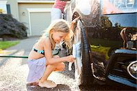 Young daughters help father wash their car in the driveway of their home on a sunny summer afternoon in Portland, Oregon, USA Stock Photo - Premium Royalty-Freenull, Code: 600-06531474