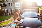 Family washing their car in the driveway of their home on a sunny summer afternoon in Portland, Oregon, USA Stock Photo - Premium Royalty-Free, Artist: Ty Milford, Code: 600-06531475