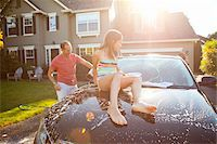 Family washing their car in the driveway of their home on a sunny summer afternoon in Portland, Oregon, USA Stock Photo - Premium Royalty-Freenull, Code: 600-06531476