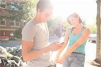 Couple Outdoors, Man using Cell Phone, Portland, Oregon, USA Stock Photo - Premium Royalty-Freenull, Code: 600-06531558