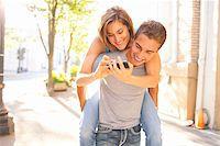 Couple Outdoors, Man Piggybacking Woman, Portland, Oregon, USA Stock Photo - Premium Royalty-Freenull, Code: 600-06531561