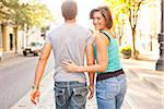 Couple Walking Outdoors, Woman Looking over Shoulder, Portland, Oregon, USA Stock Photo - Premium Royalty-Free, Artist: Ty Milford, Code: 600-06531568