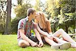 Young Couple Sitting on the Ground and Kissing in Park on a Summer Day, Portland, Oregon, USA Stock Photo - Premium Royalty-Free, Artist: Ty Milford, Code: 600-06531620
