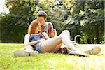 Young Couple in Park on a Summer Day, Portland, Oregon, USA Stock Photo - Premium Royalty-Free, Artist: Ty Milford, Code: 600-06531626