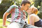Young Couple Kissing in Park on a Summer Day, Portland, Oregon, USA Stock Photo - Premium Royalty-Free, Artist: Ty Milford, Code: 600-06531627