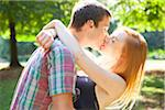 Young Couple Kissing in Park on a Summer Day, Portland, Oregon, USA Stock Photo - Premium Royalty-Free, Artist: Ty Milford, Code: 600-06531634