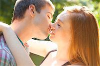Young Couple Kissing in Park on a Summer Day, Portland, Oregon, USA Stock Photo - Premium Royalty-Freenull, Code: 600-06531635