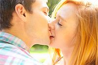 Young Couple Kissing in Park on a Summer Day, Portland, Oregon, USA Stock Photo - Premium Royalty-Freenull, Code: 600-06531636