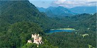 Panoramic View of Hohenschwangau Castle with Lake and Mountains in Background, Fussen, Ostallgau, Bavaria, Germany Stock Photo - Premium Rights-Managednull, Code: 700-06531642