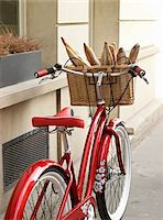 red, classic, road bicycle with wicker basket attached to handlebars filled with baguettes from bakery, Paris, France Stock Photo - Premium Rights-Managednull, Code: 700-06531925