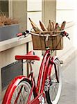 red, classic, road bicycle with wicker basket attached to handlebars filled with baguettes from bakery, Paris, France Stock Photo - Premium Rights-Managed, Artist: Michael Mahovlich, Code: 700-06531925