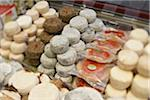 Fresh wedges and rounds of French goat cheese in artisan cheese shop, La Fromagerie, Paris, France Stock Photo - Premium Rights-Managed, Artist: Michael Mahovlich, Code: 700-06531954
