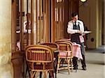waiter clearing dishes at charming outdoor cafe, Fontaine de Mars, Paris, France Stock Photo - Premium Rights-Managed, Artist: Michael Mahovlich, Code: 700-06531968