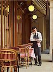 waiter clearing dishes at charming outdoor cafe, Fontaine de Mars, Paris, France Stock Photo - Premium Rights-Managed, Artist: Michael Mahovlich, Code: 700-06531969