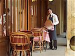 Portrait of Waiter Holding Tray at Charming Outdoor Cafe, Fontaine de Mars, Paris, France Stock Photo - Premium Rights-Managed, Artist: Michael Mahovlich, Code: 700-06531971