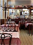 Interior of empty restaurant cafe with coat rack and tables set with wine glasses, Fontaine de Mars, Paris, France Stock Photo - Premium Rights-Managed, Artist: Michael Mahovlich, Code: 700-06531974