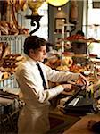 Waiter in Wearing Shirt, Tie, and Apron Operating Cash Machine in Bakery, Paris, France Stock Photo - Premium Rights-Managed, Artist: Michael Mahovlich, Code: 700-06531976