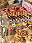 assorted sweet pastries and baked goods arranged in rows in glass bakery display case on countertop Stock Photo - Premium Rights-Managed, Artist: Michael Mahovlich, Code: 700-06531980