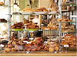 assorted pastries and baked goods stacked on display on glass shelves on bakery counter Stock Photo - Premium Rights-Managed, Artist: Michael Mahovlich, Code: 700-06531981