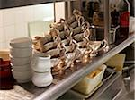 Stacks of silver gravy boats in restaurant kitchen Stock Photo - Premium Rights-Managed, Artist: Michael Mahovlich, Code: 700-06531984
