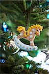 gingerbread rocking horse decorated with icing hanging on a pine tree as a Christmas ornament decoration, Canada Stock Photo - Premium Royalty-Free, Artist: Yvonne Duivenvoorden, Code: 600-06532003