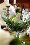 One decorative lambs ear pear in a dish with cedar branches used as a holiday table center piece Stock Photo - Premium Rights-Managed, Artist: Yvonne Duivenvoorden, Code: 700-06532027