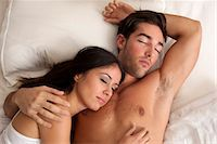 Couple sleeping in bed Stock Photo - Premium Royalty-Freenull, Code: 649-06532549