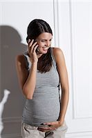 portrait of pregnant woman - Pregnant woman talking on cell phone Stock Photo - Premium Royalty-Freenull, Code: 649-06532565