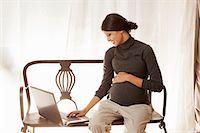 pregnant asian - Pregnant woman using laptop Stock Photo - Premium Royalty-Freenull, Code: 649-06532568
