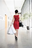 people on mall - Businesswoman walking in lobby Stock Photo - Premium Royalty-Freenull, Code: 649-06532598