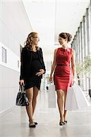 people on mall - Businesswomen talking in lobby Stock Photo - Premium Royalty-Freenull, Code: 649-06532599