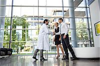 people hospital - Doctor and businessman shaking hands Stock Photo - Premium Royalty-Freenull, Code: 649-06532615