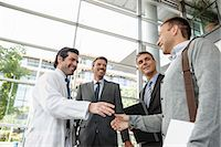Doctor and businessman shaking hands Stock Photo - Premium Royalty-Freenull, Code: 649-06532618