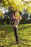 Mother and son playing in park Stock Photo - Premium Royalty-Free, Artist: Ikon Images, Code: 649-06532691