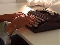 Close up of woman using typewriter Stock Photo - Premium Royalty-Freenull, Code: 649-06532751