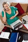 Pregnant woman on phone and laptop Stock Photo - Premium Royalty-Free, Artist: Blend Images, Code: 649-06532802