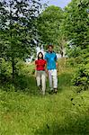 Couple walking in meadow Stock Photo - Premium Royalty-Free, Artist: Blend Images, Code: 649-06532970
