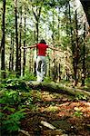 Woman walking in forest Stock Photo - Premium Royalty-Free, Artist: Michael Mahovlich, Code: 649-06532974
