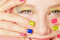 preteen beauty - Smiling girl wearing colorful makeup Stock Photo - Premium Royalty-Freenull, Code: 649-06533093
