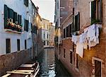 Buildings and rowboats on urban canal Stock Photo - Premium Royalty-Free, Artist: Russell Monk, Code: 649-06533204