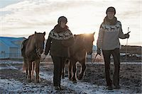 Women walking with horses outdoors Stock Photo - Premium Royalty-Freenull, Code: 649-06533304