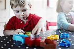 Children playing with shapes on table Stock Photo - Premium Royalty-Freenull, Code: 649-06533348