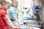 Children washing dishes together Stock Photo - Premium Royalty-Free, Artist: Aflo Relax, Code: 649-06533354