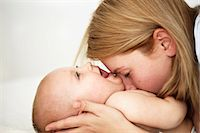 Mother playing with baby girl Stock Photo - Premium Royalty-Freenull, Code: 649-06533391
