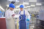 Workers talking in factory Stock Photo - Premium Royalty-Free, Artist: Blend Images, Code: 649-06533462